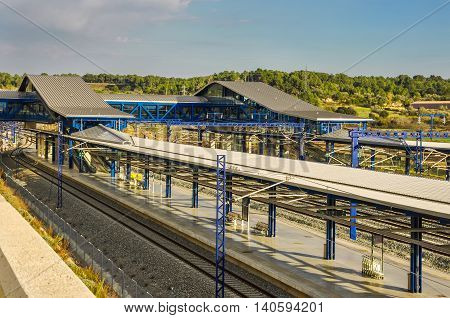 Platforms of modern railway station in Tarragona (Spain) with beautiful landscape. Horizontal.