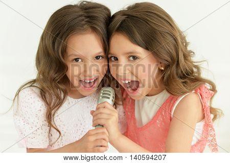 Portrait of a cute girls singing in karaoke