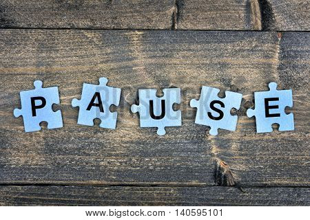 Puzzle pieces with word Pause