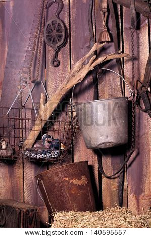 Old buckets and basket holding duck decoys hanging in an old barn.