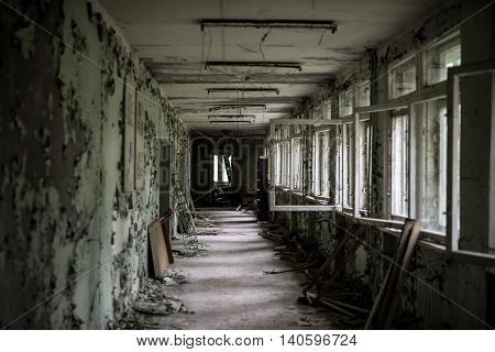 school room with turned chairs and opened window frames in Pripyat, Chernobyl, Ukraine