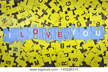 Puzzle pieces with words I love you