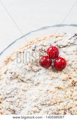 cake with a crumb and cherry close-up.