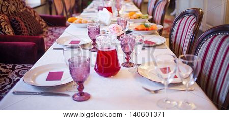 interior of the restaurant, a large table laid for a Banquet