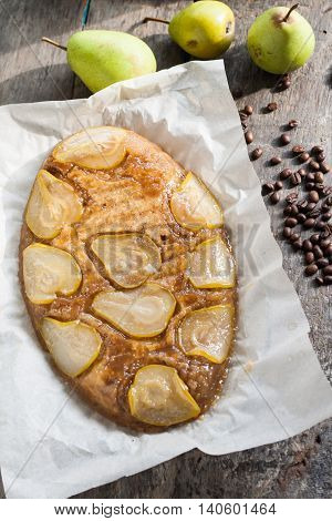 pie-overturned with coffee and a the pears.