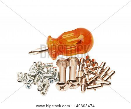 Different screws and screw-driver on a white background
