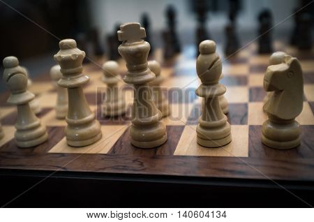 Chess pieces and board set up for beginning of game