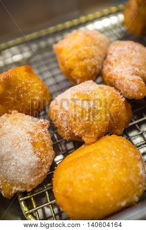 Fried sweet Chinese doughnuts on buffet server tray