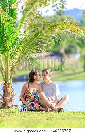 Young Couple Spending Time In A Tropical Garden