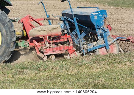 Bauer sowing cereals on arable with drill