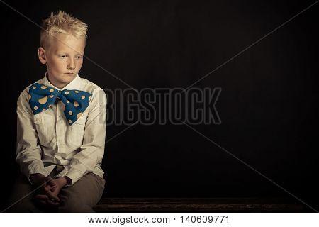 Sad Boy In Oversized Bowtie With Copy Space