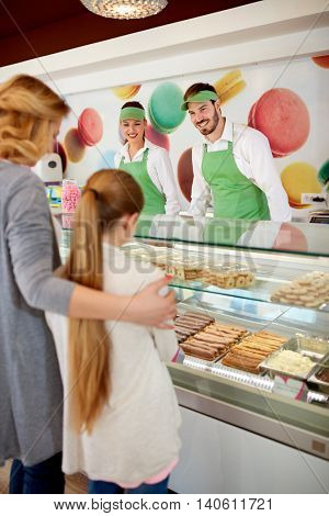 Pastry shop with female and male sellers and customers