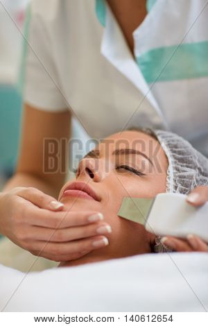 professional facial treatment with ultrasonic equipment for peeling skin