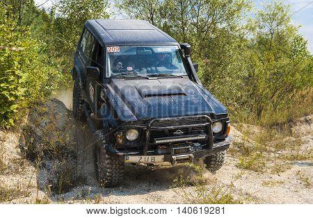 Lviv Ukraine - August 23 2015: Off-road vehicle brand Nissan overcomes the track on of sand near the city Lviv Ukraine.