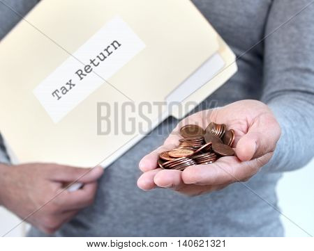 Man holding loose coins & folder with tax return documents
