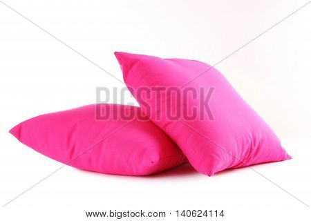 Pink pillow isolated on a white, close up