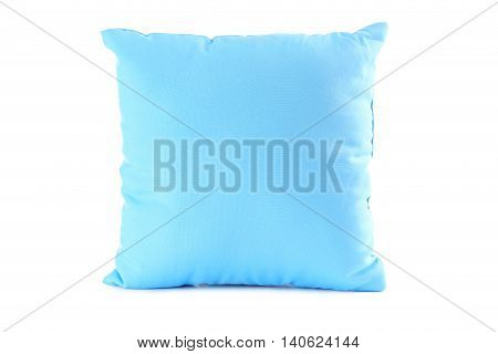 Blue pillow isolated on a white, close up