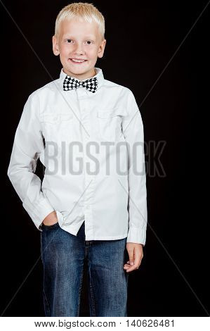 Boy Standing With One Hand In Pocket Smiles