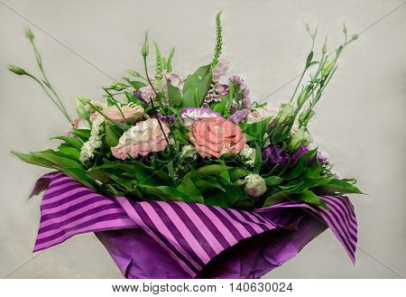 beautiful pink purple white and purple flowers flowers decorated with a beautiful bouquet in purple paper