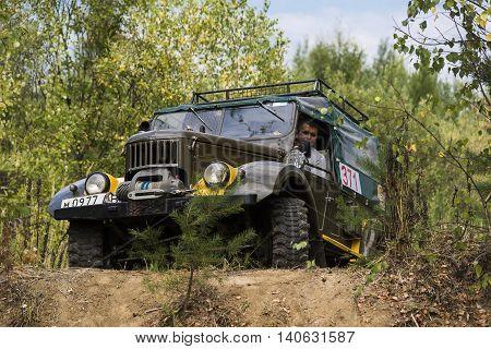 Lviv Ukraine - August 23 2015: Off-road vehicle brand GAZ-69 (UAZ) overcomes the track on of sandy career near the city Lviv Ukraine.