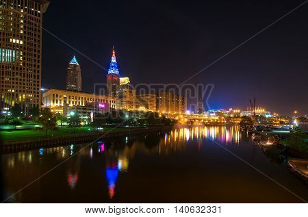 CLEVELAND OH - MAY 28 2016: View of Cleveland's riverfront with colorful Terminal Tower and Quicken Loans Arena (the Q) the site of the NBA Finals and of the Republican National Convention in July.