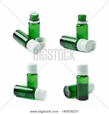 Small green glass flask vial, composition isolated over the white background, set of four different foreshortenings