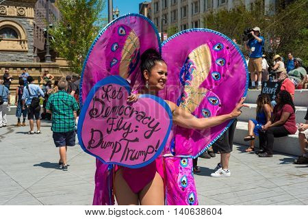 CLEVELAND OH - JULY 20 2016: A colorful protester dressed as a butterfly shares an anti-Trump message on Public Square during the Republican National Convention.