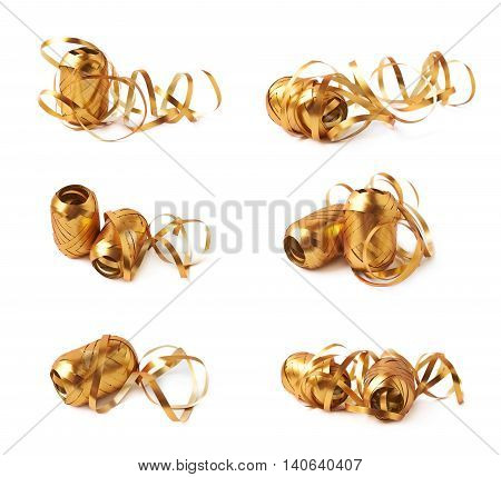 Glossy golden ribbon reel partly unwrapped, composition isolated over the white background, set collection of six diffirent foreshortenings