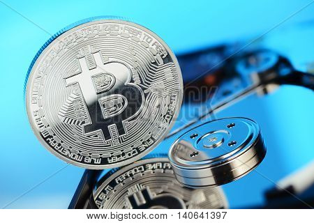 Silver Bitcoin coin on the opened HDD disk. Electronic money cryptocurrency