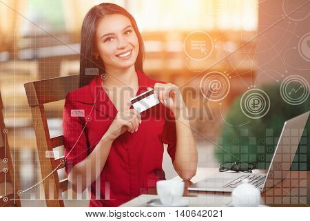 Business woman holding credit card and looking at the camera. Woman pays for a purchase with credit card. Purchase on the Internet. Buy and shopping online. Business infographic