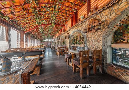 MOSCOW - JULY 2014: The interior of the enclosed porch of the restaurant