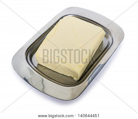 Butter in a metal flatware for butteron a white