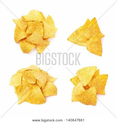 Pile of multiple corn yellow tortilla chips snacks, composition isolated over the white background, set of four different foreshortenings