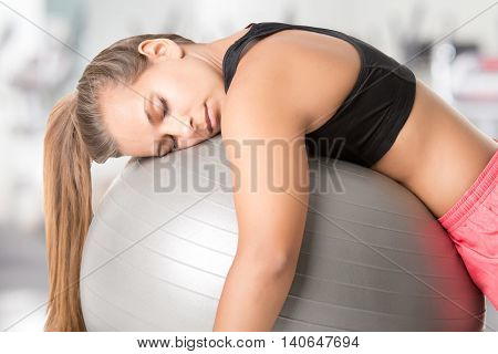 Woman Falling Asleep In The Gym
