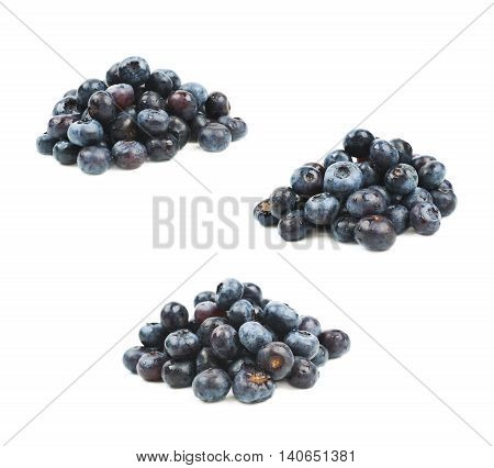 Pile of ripe bilberries isolated over the white background, set of three different foreshortenings
