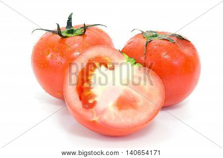 Tomato fruit (Other names are Solanum lycopersicum Solanaceae tomatl tomate in Spanish tomatillo in Mexican Adean fruit xitomatl jitomates) with half cross section isolated on white