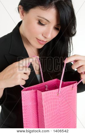 Woman Opening Up A Gift Bag