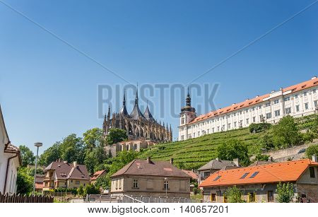 Saint Barbara Cathedral and Jesuit college with a small vineyard on the hill.