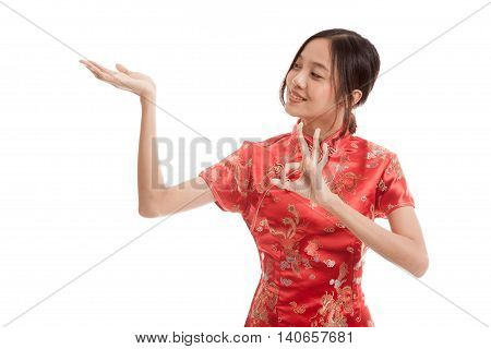 Asian Girl In Chinese Cheongsam Dress  Show Ok With  Blank Space On Her Hand