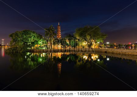 the oldest Buddhist temple in Hanoi, is located on a small island near the southeastern shore of Hanoi's West Lake, Vietnam.