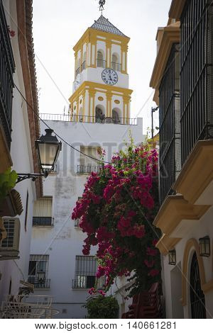 church, architecture and streets of white flowers in Marbella Andalucia Spain