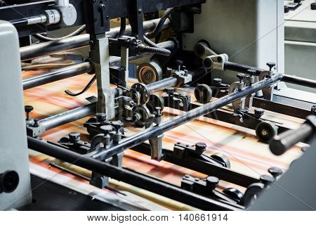 printing leaflets in a modern printing house