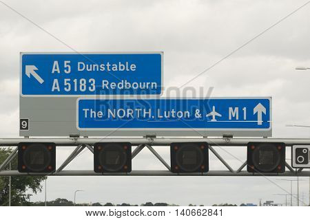 Motorway sign to the North of England. Mentioning Luton Luton Airport Dunstable and Redbourn