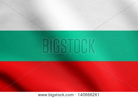 Flag of Bulgaria waving in the wind with detailed fabric texture. Bulgarian national flag.