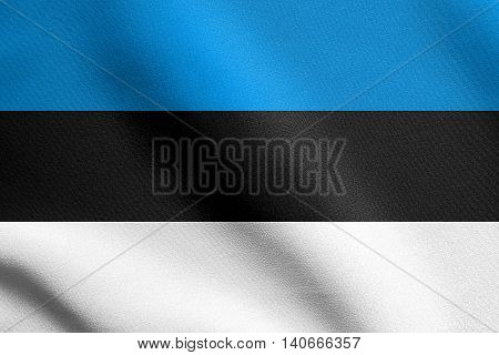 Flag of Estonia waving in the wind with detailed fabric texture. Estonian national flag.