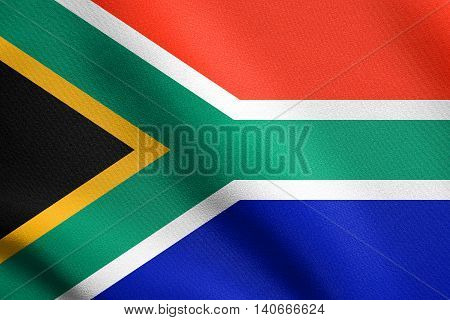 Flag of South Africa waving in the wind with detailed fabric texture. South African national flag.
