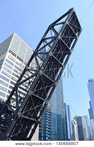 CHICAGO ILLINOIS - JULY 23rd 2016: Drawbridge along the Chicago River in front of the Chicago Sun-Times building in the downtown area on a sunny day