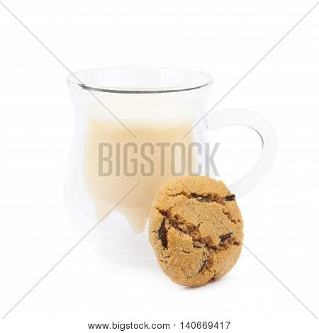 Soft chewy chocolate chip cookie next to a glass of milk, composition isolated over the white background