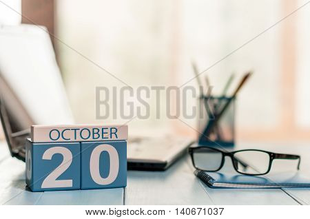 October 20th. Day 20 of month, calendar on freelancer workspace background. Autumn time. Empty space for text.