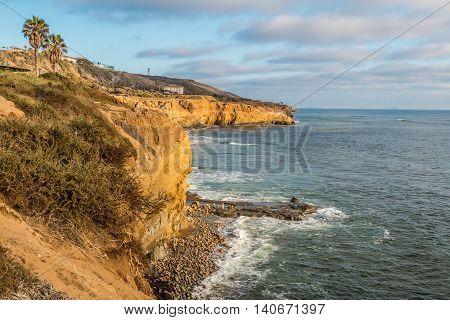 Side of cliff with ocean below at Sunset Cliffs in San Diego, California.